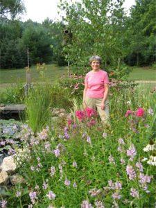 Joyce Sobotta in her garden